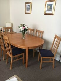 Ikea Oak Veneer Dining Table and 6 chairs ... navy upholstery on seats.