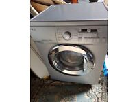 LG SILVER WASHER/DRYER