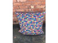 Large floor cushions. Slight tear on one edge of cushion, otherwise good condition