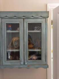 Shabby chic wall cupboard.