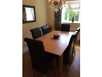Oak Effect Extending Table & Six Faux leather Chairs