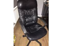Black swivel and adjustable office chair