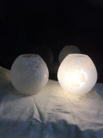 Pair of switched floral patterned globe electric lights , £2.50 each Ron 07860629420