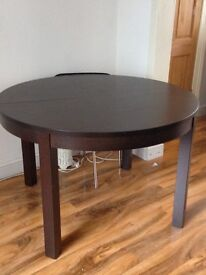IKEA BJURSTA extendable table in black brown colour