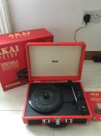 Akai A60011NR Bluetooth Rechargeable Vinyl Turntable Briefcase Style Featuring