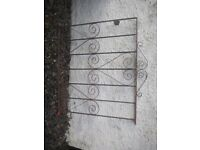 Traditional iron scrollwork gate