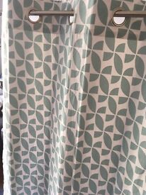 Dusky green patterned curtains