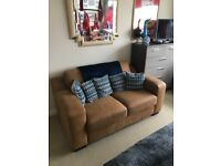 2 seater suede sofa brand new