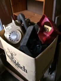 Box of old telephones, some bakelite parts