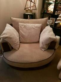 Cuddle Chair in cream and brown.