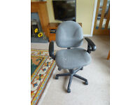 Grey swivel office chair in good condition