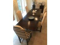 JayCee Dark Oak extending dining table with six individually upholstered chairs.