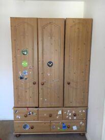 Triple wardrobe with 5 drawer unit underneath