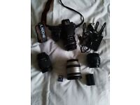 Sony A58 and 18-55 kit lens, also Sony 18-70,Sony 70-210, minolta 35-70 lenses extra battery and bag