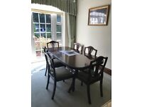 Mahogany extending dining table with 8 chairs