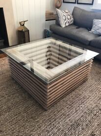 Illuminating Glass and wooden coffee table