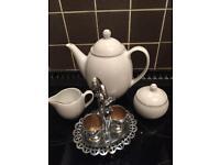 Tea pot. Milk jug. Sugar bowl