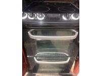 Electric ceramic cooker with double oven and grill