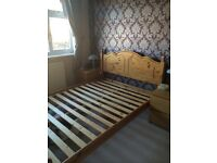 Wooden double bed frame. Good condition.