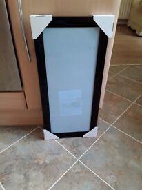 Picture frame 22x54cm. Black gloss frame. Brand new.