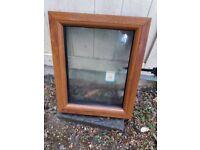 Golden oak/rosewood UPVC window