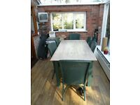 A strip plank dining table with 6 Lloyd Loom chairs