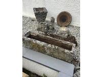 Various stone ornaments for garden , two troughs , pedestal bases , lion ornament etc