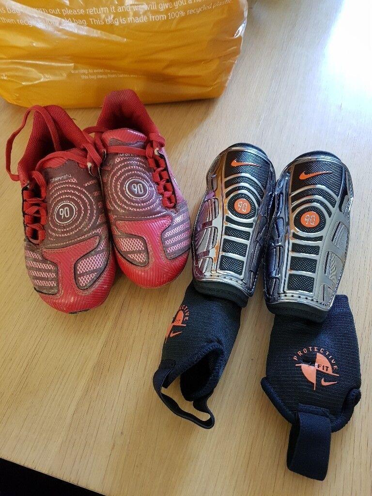 1b57b3f768e Kids football boots and shin pads
