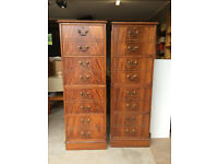 Two walnut veneer four drawer filing cabinets