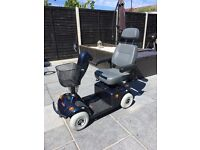 Dark blue freerider mobility scooter with grey leather seat, great condition with basket on front