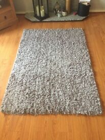 Large light grey rug