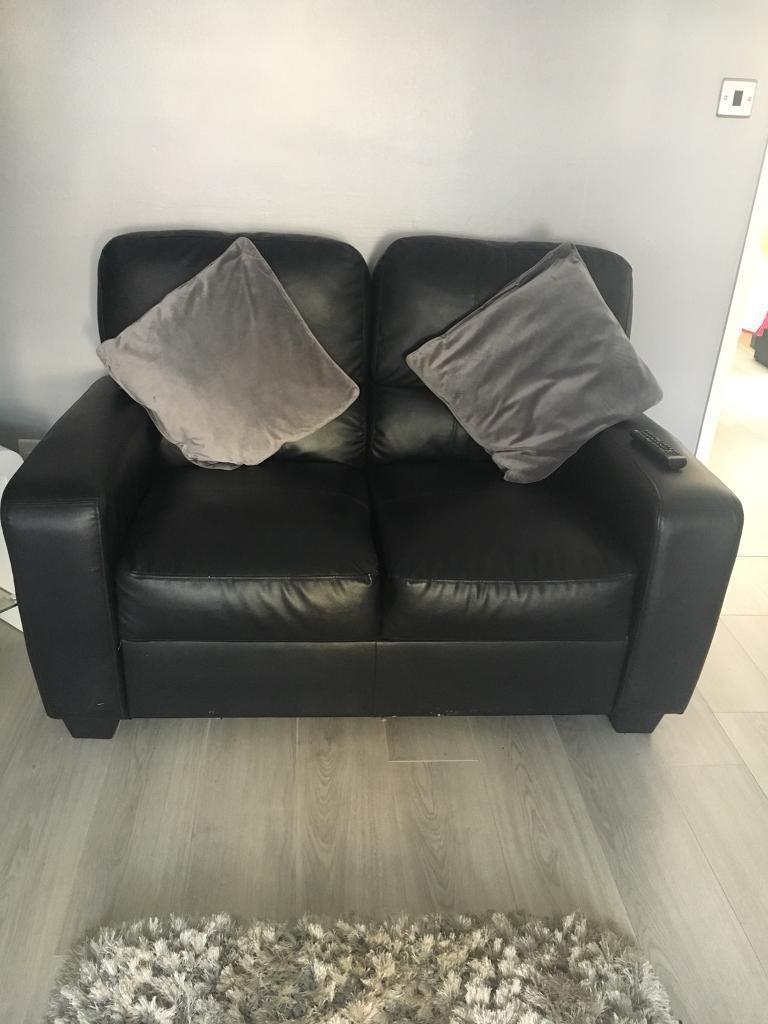 2 seather black leather sofa