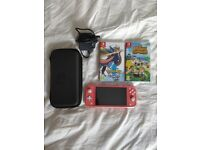Nintendo Switch Lite Coral + 2 games + travel case + case + 2 screen protectors