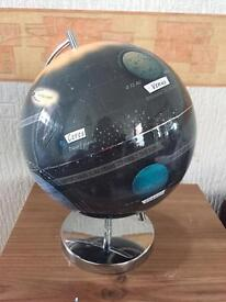 Solar system globe also works as night light for young souls.