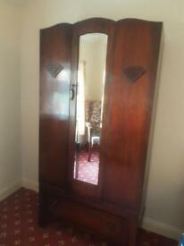 Double wardrobe with a mirror and a bottom draw