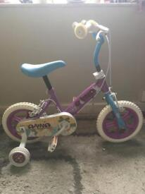 Girls purple, blue and white bike with stabilisers ad adjustable handle bars and saddle