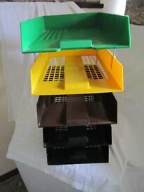 Set of 5 plastic filing trays - mixed colours. As new condition. Price is for the set.