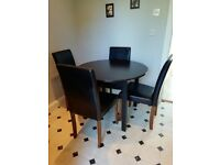 Round black/brown dining table and 4 chairs