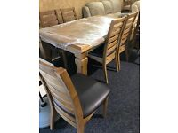 New-exDisplay solid OAK table and new six OAK chairs