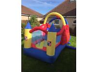 Bouncy Castle with inflatable slide at one side and bouncy castle at other side. Complete with fan