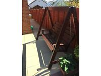 Wooden garden bench swing