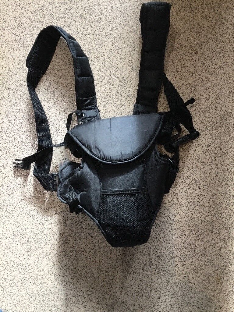 Baby carrier, carrying harness