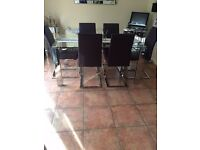 Harweys Glass Dining Table and 6 purple leather chairs