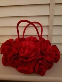 Red ruffle handbag