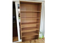 Light oak, tall book shelf with 5 shelves. Good condition. MDF back.