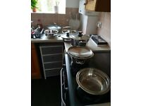 Set of 6 never used 'swiss line' pots and pans. Plus one never used 'Thomas' wok.