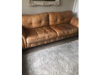 Lovely tan/ sand colured aniline leather with large curved arms.