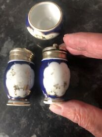 blue and white porcelain condiment set with gold design
