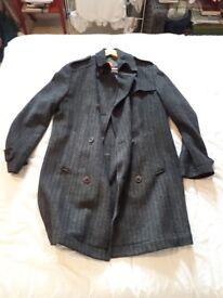 Hugo Boss Winter Coat. Super Stylish. Size L. Used but hardly worn.