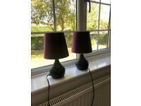 Two purple bedside lamps